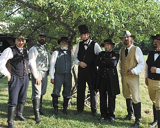 Civil War reenactors who will participate in the 105th Ohio Volunteer Infantry's reenactment July 21 and 22 are, from left, Don VanMeter, as a major; Mike Lawson, as General Stonewall Jackson; Ed Beers, as General Robert E. Lee; Jerry Payne, as President Abraham Lincoln; Chris Gunvalsen, as General William Tecumseh Sherman; Ron Johnson, as General Nathan Forest; and Tim Perry, as a colonel.