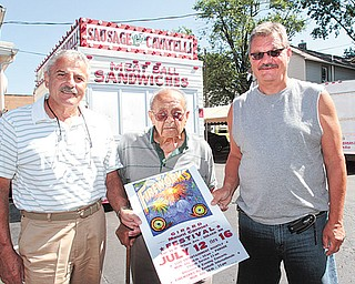 From left, Myron Esposito, Girard Mount Carmel society co-chairman, Fred Ragozzine, and Ray Ragozzine, chairman of the Girard Mount Carmel Society, stand outside the Italian Fraternal Home in Girard, the location of this year's Mount Carmel festival.