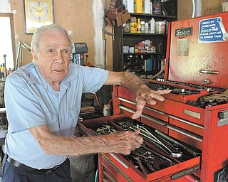 Robert Thomas, at home in Canfield, shows off the tools in his garage workshop. In addition to his more than 60 years as an HVAC technician, he also was a pilot in the Army Air Corps during World War II.