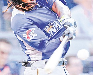 Andrew McCutchen of the Pittsburgh Pirates swings during Monday's Home Run Derby in Kansas City, Mo. McCutchen's MVP-caliber play has the Pirates in position for a division race.