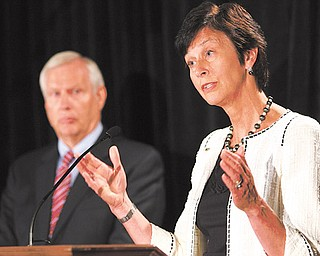 Karen Peetz, chairwoman of the Penn State Board of Trustees, talks as Rodney Erickson, left, university president, listens in during a news conference at the Hilton Hotel in Scranton, Pa. Board members answered questions after the Freeh Report on the sex scandal implicated university officials Thursday.
