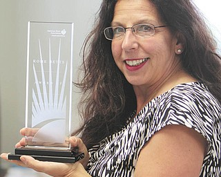 Charlotte, Diss, senior director of the local American Heart Association, was awarded the association's top honor, the Rome Betts Award, for her dedication to AHA's mission of building healthier lives free from cardiovascular disease and stroke.