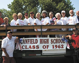Canfield High School Class of 1962 began its 50th anniversary celebration by participating in Canfield's Fourth of July parade. Pictured are, front, Jim Young, left, and Richard Taylor, and back from left, the Rev. Jay Eastman, Jane Greasel, Donna Gromley-Alexander, Sandie McKnight-Brown, Wes Coy, Harry Mitchel, Linda St. Clair-Miller, Kathy Hanas-Wolfe, Sandra Durr-Bowen, Betsy Enterline-Weimer, Gary Weimer, Bob Nell and the Rev. Russ Libb. Other activities will include attending the Sept. 21 Canfield High and Poland High School football game followed by a social at Hampton Inn in Canfield; Sept. 22 golf outing at Diamond Back Golf Course followed by a tour of the old Canfield School on Wadsworth Street and banquet at Hampton Inn. For information, call McKnight-Brown at 330-547-4004 or send email to sandiebrown11@yahoo.com.