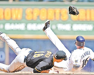 Pittsburgh Pirates' Neil Walker, left, gets his glove kicked out of his hand by Milwaukee Brewers' Aramis Ramirez as he steals second base during the sixth inning of a game Sunday in Milwaukee.