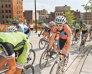 Men Pro 1/2 racers leave downtown Youngstown heading for Youngstown State during their 90-minute criterium at Sunday's final day of the Tour of the Valley.
