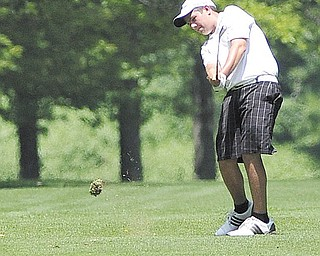 Donavon Ray follows through on his swing from the fairway on the on the 14th hole at Tamer Win in Cortland at Monday's Greatest Junior Golfer of the Valley qualifier. Ray's 80 placed second and secured a qualifying spot for Saturday's 12-14-year-old finals.