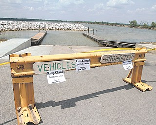The state boat launch ramp into Mosquito Lake off the state Route 88 causeway, where the water depth is 2 feet and falling, was closed indefinitely Tuesday due to the drought-reduced water level.