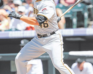 The Pittsburgh Pirates' Garrett Jones follows the flight of his leadoff single off Colorado Rockies relief pitcher Matt Reynolds in the fifth inning of Wednesday's baseball game in Denver. The Pirates rallied to defeat the Rockies, 9-6, with Jones having three hits, including one of Pittsburgh's four home runs.