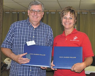 East Palestine Rotary Club members John Davis, left, and Kerri Stewart recently received Paul Harris Fellow