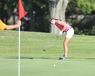 Christine Cooper, Canfield, watches her putt on her way to an 83 and second-place title. She was playing in the 2012 Greatest Golfer of the Valley junior finals Saturday at Trumbull Country Club. Adult finals are Aug. 24, 25 & 26.