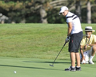 Haleigh Guerrero lines up a putt with her grandfather caddying. Guerrero was playing in the 2012 Greatest Golfer of the Valley junior finals Saturday at Trumbull Country Club. Adult finals are Aug. 24, 25 & 26.