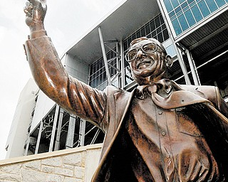 A statue of former Penn State head football coach Joe Paterno stands on the school's campus. The statue was removed on Sunday, eliminating a key piece of the iconography surrounding the once-sainted football coach.