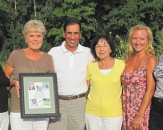 Vickie Maietta, second from left, holds a remembrance frame with the photos of Youngstown Police Department officers who died of cancer in the past year and a half and who were honored at the 21st annual charity golf benefit June 22 at Pine Lakes Golf Course in Hubbard. She and other committee members, from left, Sue Centorame, Fred LoSasso, Carlotta Kane, Laura Brown and Debra DeMatteo, arranged the benefit, dedicated to Capts. Kenny Centorame and Bob Kane and detective Sgts. Jerry Maietta and Joe DeMatteo. It raised more than $33,000, which will go to scholarships for children of YPD officers and civilians attending Youngstown State University. Other committee members were John Patton, Tony Tulipano, Tony Marzullo and Jerry Slattery. Contributing to the event's success were platinum sponsors Dr. Denise Bobovnyik and Michael Bruno. Gold sponsors were Briarfield at the Ridge, Centorame, City Disposal Services, Denise DeBartolo-York, DeMatteo, Environmental Specialists, Kane, Vickie Maietta, Victor and Diane Perez, Harry Wollet, Youngstown Police Association, and Youngstown Police Ranking Officers, and silver sponsors were A.P. O'Horo, Dr. Vincent Paolone, Drs. James and Cynthia Kravec, the Rev. Edward Neroda, GLI Pool Products, HBK, Huntington Bank, Knoll Run Golf Course, Daryl and Luann Martin and family, Daryl and Vickie Mincey, Transit Service Inc., Jim Tressel, YSU Foundation and Ziegler Tire. The event attracted 144 golfers and had more than 25 prizes in the basket auction, a 50/50 drawing, IPAD raffle and dinner. Donations may be directed to Laura Brown at 330-742-8718 or email Labro63@aol.com. The next outing will be June 28, 2013, at Pine Lakes.