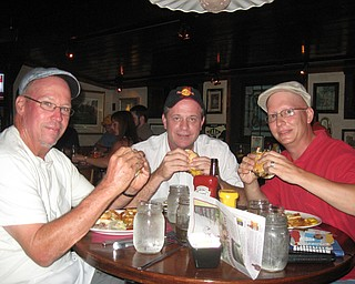 Mahoning Valley Burger Review Board members Scott Long, Jerry Tranovich and Anthony Fuda, enjoy their burgers at the Iron Bridge Inn.