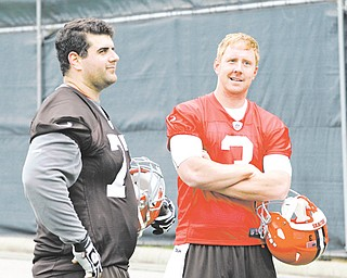 Browns rookie quarterback Brandon Weeden (3) chats with OL John Greco, a Boardman High grad, at a preseason practice. While Cleveland is counting on Weeden to make an immediate impact, coach Pat Shurmur is mum on which QB will get the starting nod.