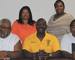 The Black Knights Police Association of Youngstown chose new officers to direct the organization for the next two years. The election took place July 21. New officers are, from left to right, seated, Cortland Casey, vice president; Jimmy Hughes, president; and Anita Davis, treasurer.
