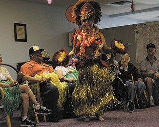 Canfield resident Lana VanAuker just loves to dance. She says she dances everywhere she goes — Italy, Spain, Morocco, Hawaii and right here at home in Mahoning and Trumbull counties. Her most recent audience was a group of senior citizens at the Senior Independence adult day care in Boardman, where she donned a traditional Hawaiian costume and performed the hula. Photo by: MADELYN P. HASTINGS | THE VINDICATOR