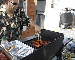 Mark DiRienzo grills ribs with his signature barbecue sauce at the fourth annual Rib Festival at Mastropietro Winery in Berlin Center, Ohio on July 21, 2012. This is his second year at the festival.