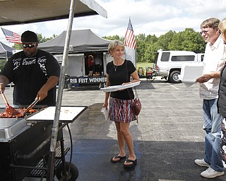 (L-R) Steve Jackson, Sherry Grant, Ken McCann, and Betty McCann at the Mastropietro Winery in Berlin Center, Ohio for the fourth annual ribs festival.