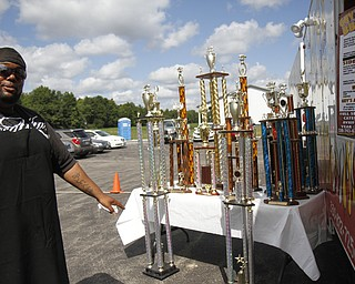 Steve Jackson shows off his many awards from various rib contests at the fourth annual ribs festival at the Mastropietro Winery in Berlin Center, Ohio.
