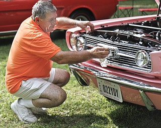 Sam Martuccio shines his daughter's car at the car show in Woodland Park in McDonald, Ohio. He built the 1966 Mustang for his daughter, Lucua Martuccio.