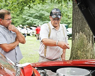(L-R) Joe Mistak and Frederick Ross talk about Ross' 1926 Corvette at the car show in Woodland Park.