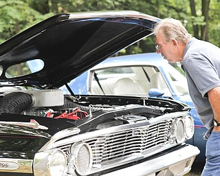 Bob Miller looks at a car at the car show in McDonald, Ohio.