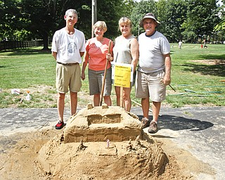 (L-R) Mark Dolak, Jan Crewson, Linda Armstrong and Carl Antonelli make up the group 'Wedesday Walkers' competing in the sand sculpture contest at Mill Creek Park.