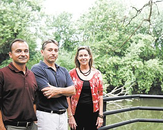 (L-R) Pat Billett, John Kwolek, and Patricia Natalie make up 3 of the 5 Friends of the Mahoning River. They plan to fundraise for the cleaning of the Mahoning River to remove contaminated sediments and make it a more functional area. They are seen behind the B & O restaurant which has a direct view of the river in Youngstown, Ohio.