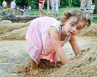 Veronika Aey, 2, plays in a pile of sand at the sand sculpture contest at Mill Creek Park in Youngstown, Ohio on July 29, 2012.