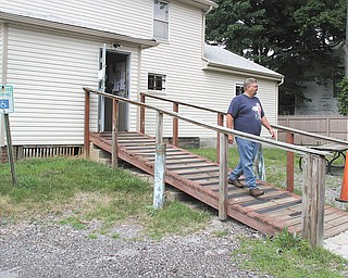 Raver walks down the handicap ramp, which also will be updated. The post has about 105 members.