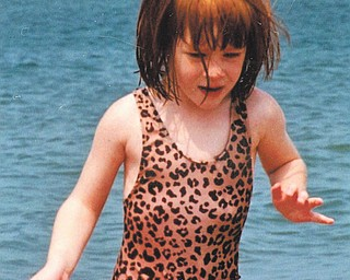 Sue Devon sent in this picture she took of her then-3-year-old daughter Emily playing at a Lake Erie beach.