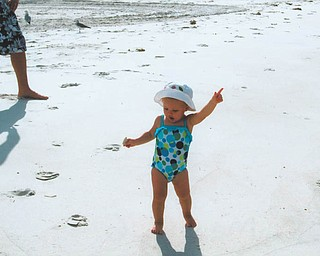 Is that a disco move? Mena Monroe, 22 months, delights in having fun at St. Pete Beach in Florida. She's the granddaughter of Russell and Ellen Monroe of Austintown.