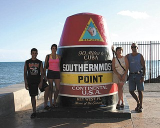 A trip to Key West isn't complete without visiting the southern-most U.S. point. Here are Dominic and Lisa Pannunzio, along with Andrea and Anthony.