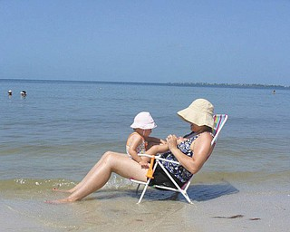 Mommy and Camryn spend some time by the water on Fort Myers Beach. Photo sent in by Kelly Alexander.