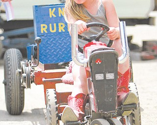 Myer Miller age 5 of Columbiana puts her pedal to the medal as she is in the Kid's Pedal Tractor Pull -  she pulled the weights for 11 feet - Columbiana Fair  est 1845 The Columbiana Fair is again on till Aug 5.