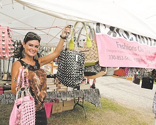 "Different Fair as  Kerry Florie of Boardman - shows off her bling purses at the fair -  ""Fashions on the go""