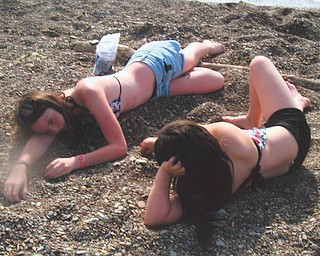 Kay Lee, 14, and Kacey, 10, Whistler are looking for beach glass on the beach at Lake Erie.