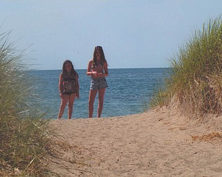 Sisters Kacey, 10, and Kay Lee, 14, Whistler enjoy a day in the sun at Lake Erie.