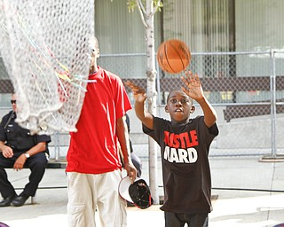 Mel Edwards, 9, shoots hoops in attempt to win a prize at the Greater Youngstown Italian Festival on August 4, 2012.