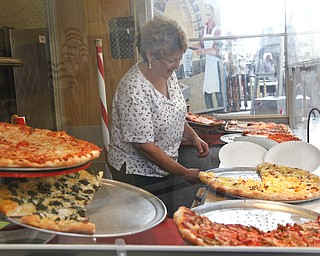 Rosemary Colaizzi works her pizza stand, Paisano's Pizza Connection, at the Greater Youngstown Italian Festival on August 4, 2012.