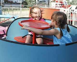 Caylee Wilkes, 3, and Arianna, 3, take a spin on a ride at the Greater Youngstown Italian Festival on August 4, 2012.