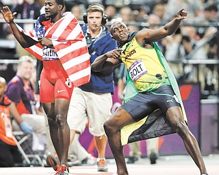 American Justin Gatlin, left, and Jamaica's Usain Bolt celebrate their medal-winning performances in the 100-meter dash during Day 9 of competition at the 2012 Summer Olympics in London. Bolt raced to a gold, joining Carl Lewis as only men to repeat as 100-meter champs. Gatlin earned bronze.
