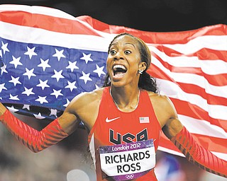 Sanya Richards-Ross waves the American flag after winning the women's 400-meter during Day 9 of competition at the 2012 Summer Olympics in London. Compatriot Deedee Trotter joined Richards-Ross on the podium as the bronze-medal winner.