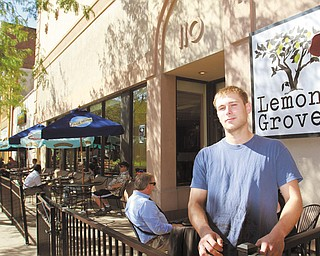 Jacob Harver, the owner of The Lemon Grove, stands in front of the restaurant's new location at 110 W. Federal St., where a grand-opening event will be Thursday starting at 7 p.m., featuring local music and food.