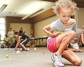 Anabella Soanes-Carter, 9, of Boardman, Ohio collects eggs during the 'Live Pacman' game at the Boardman Library on August 9, 2012.