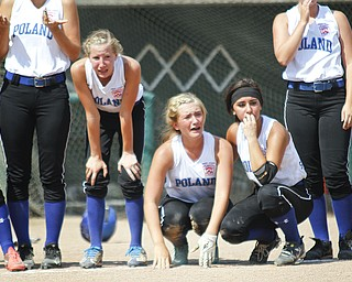 (L-R)Kat Wilson, Cara Kalduris and Jenna Schettler react to the loss of the game.