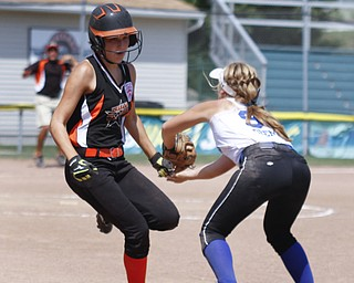Ally Deemer tags an Escanaba All Star out on first base.