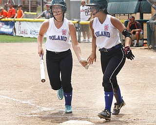 Alley Deemer (L) congratulates Jenna Schettler (R) on her score.
