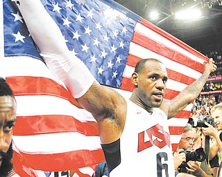The United States' LeBron James celebrates after the men's gold-medal basketball game Sunday at the 2012 Summer Olympics in London. The U.S. won 107-100.